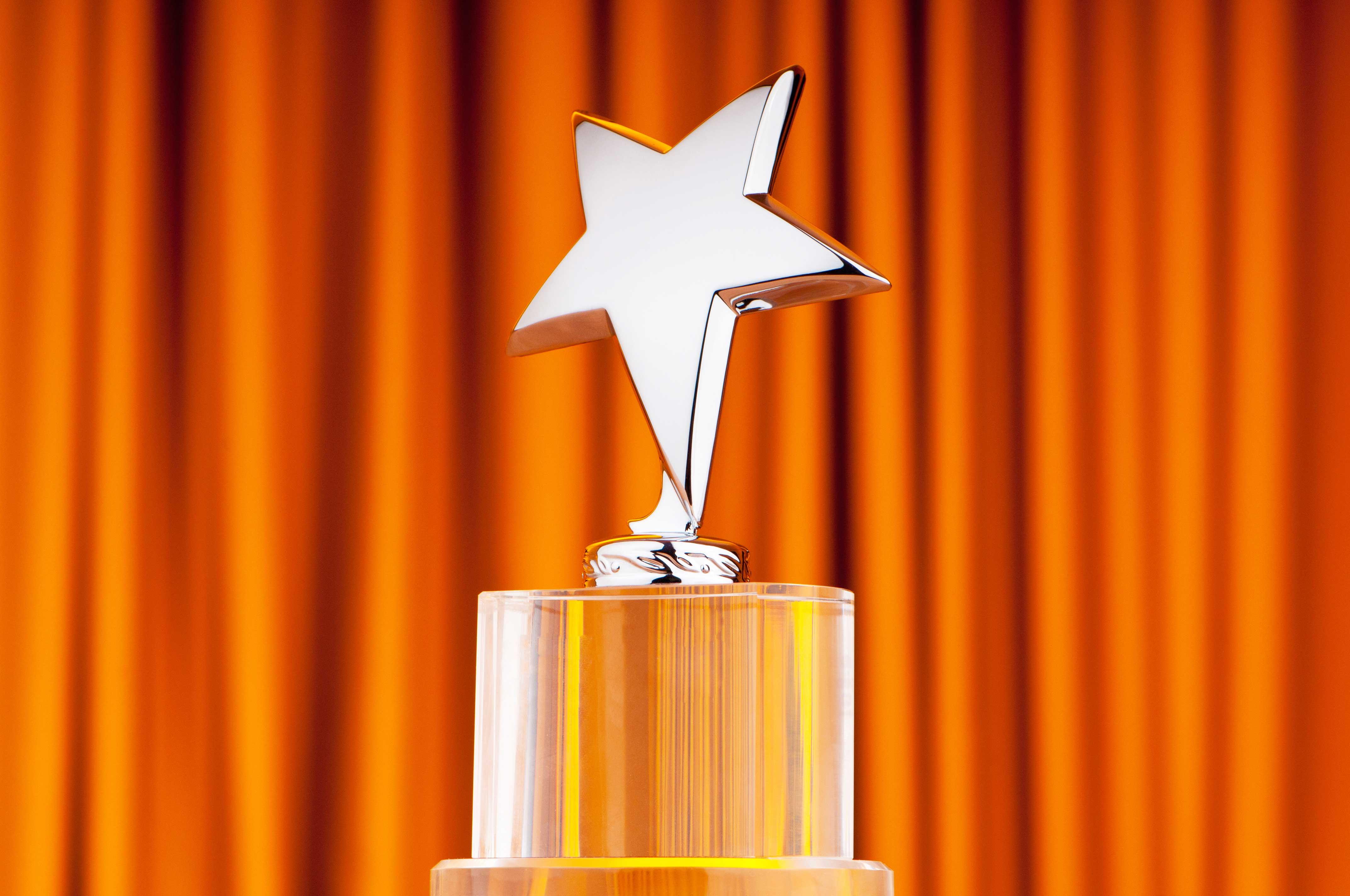 Star-award-against-curtain-background