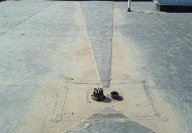 commercial roofing drain on roof