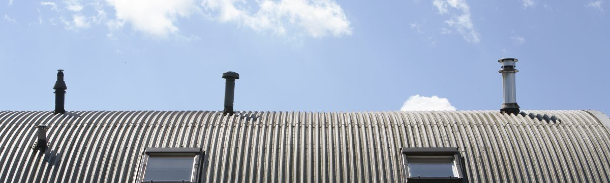 Metal roof with  windows and chimneys